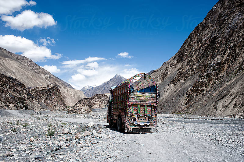 Track in typical indian style on a dirt wild road through the mountain on karakoram highway by Jean-Claude Manfredi for Stocksy United