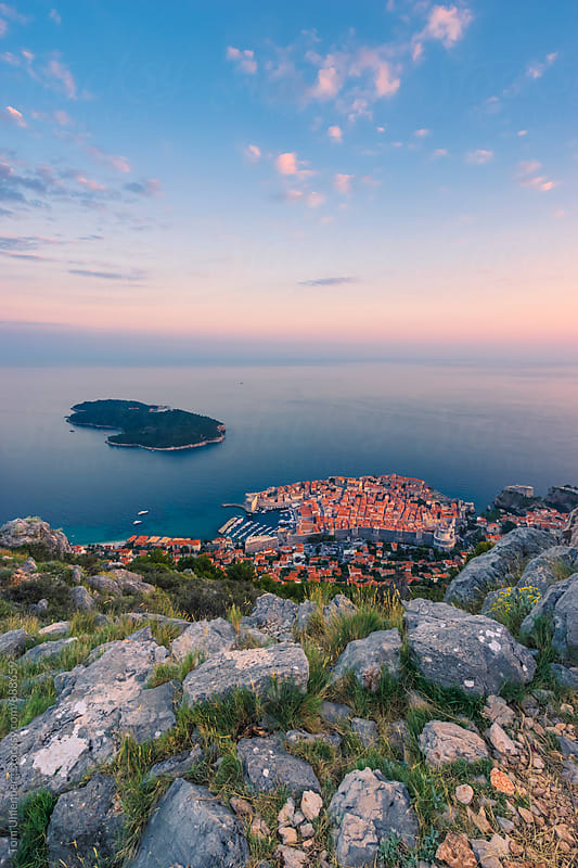 Dubrovnik, Croatia - Elevated View of the Old Town and the Island of Lokrum in Sunset Light by Tom Uhlenberg for Stocksy United