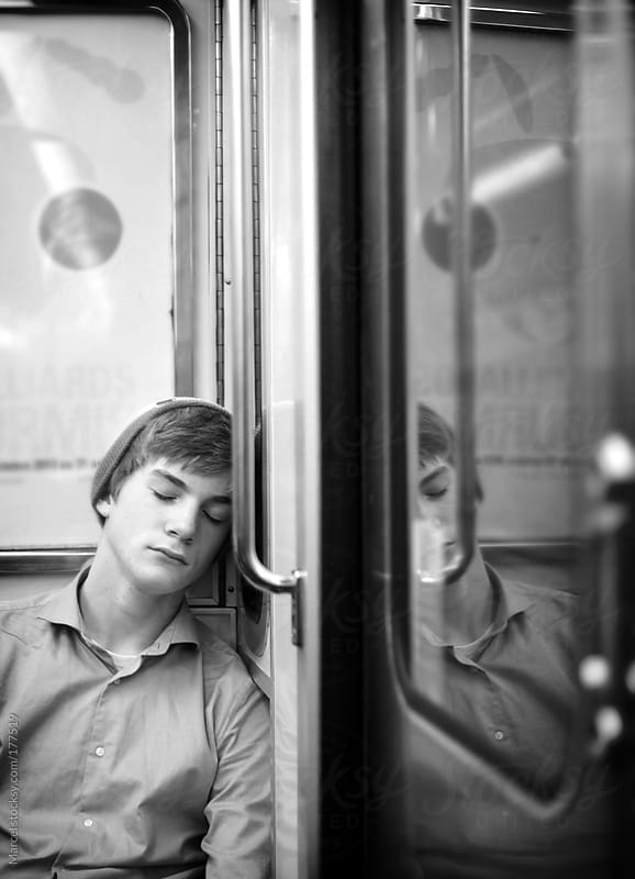 Sleeping  on the subway by Marcel for Stocksy United