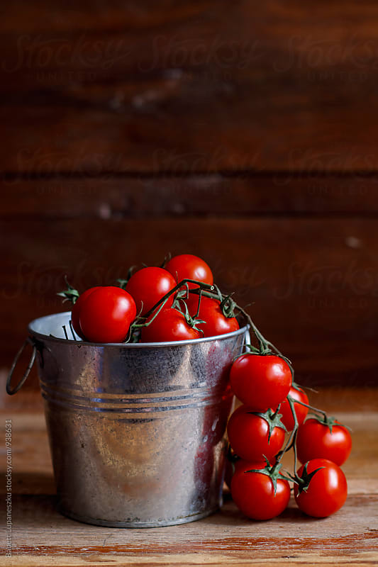 Cherry tomato by Viktorné Lupaneszku for Stocksy United