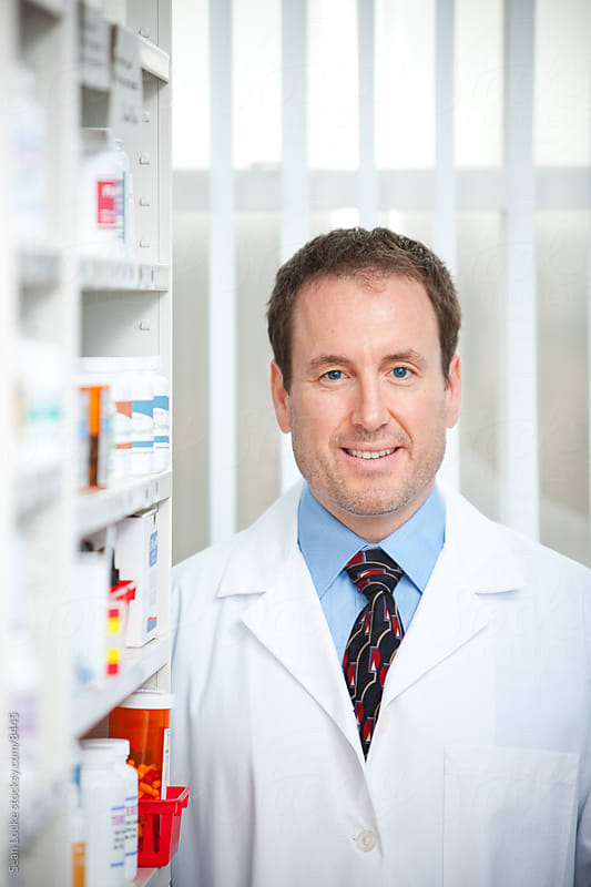 Pharmacy: Smart Pharmacist By Shelves by Sean Locke for Stocksy United