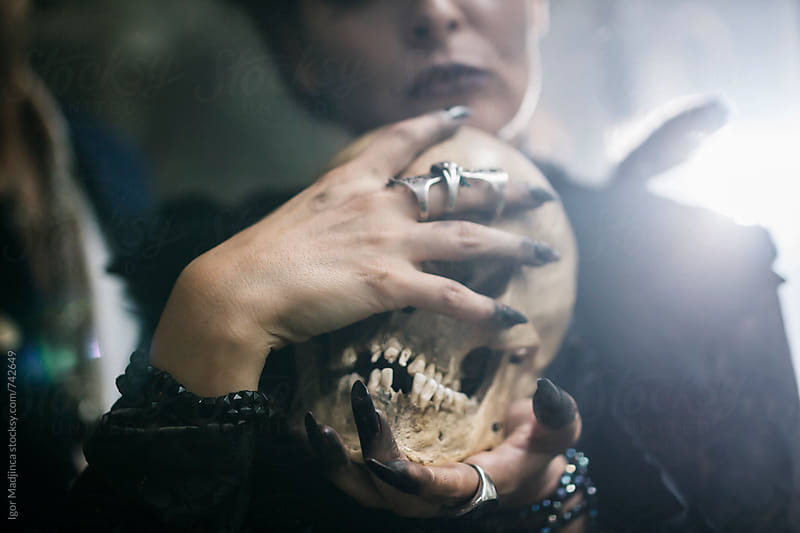 skull, Halloween witch performing a ritual by Igor Madjinca for Stocksy United