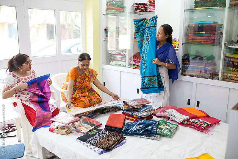 A Businesswoman deals with her client in a small shop by PARTHA PAL for Stocksy United