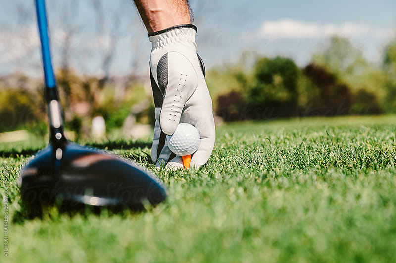 Golfer Puts the Golf Ball on a Tee by VICTOR TORRES for Stocksy United