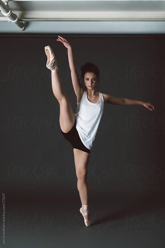Studio portrait of female dancer by Jen Grantham for Stocksy United