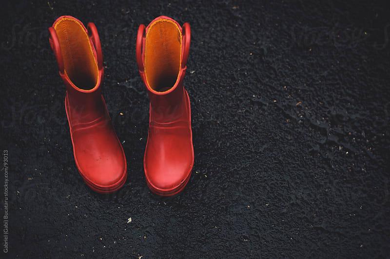 Red Rain Boots by Gabriel (Gabi) Bucataru for Stocksy United