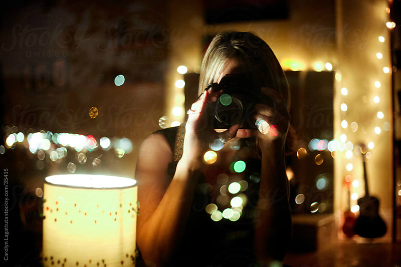 Self portrait of a photographer with lots of lights. by Carolyn Lagattuta for Stocksy United
