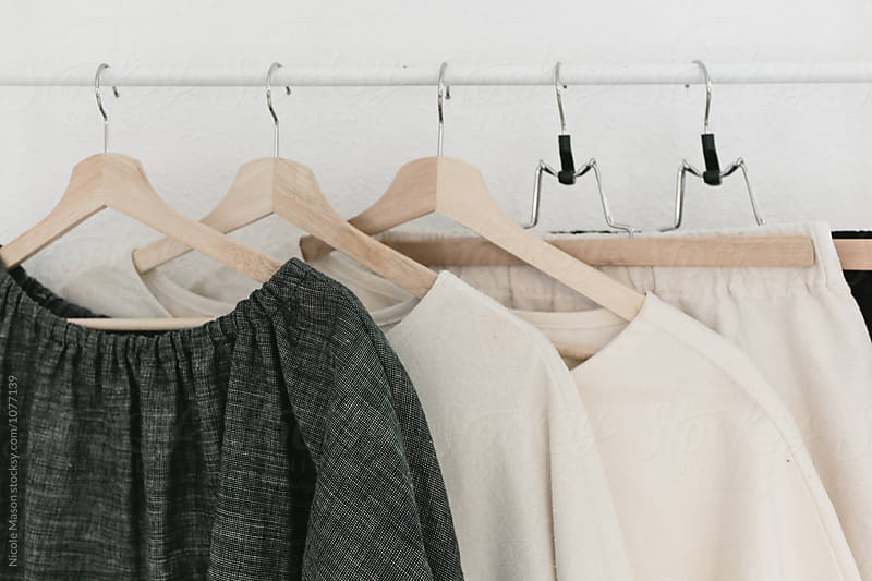 rack of clothing made by designer in studio by Nicole Mason for Stocksy United