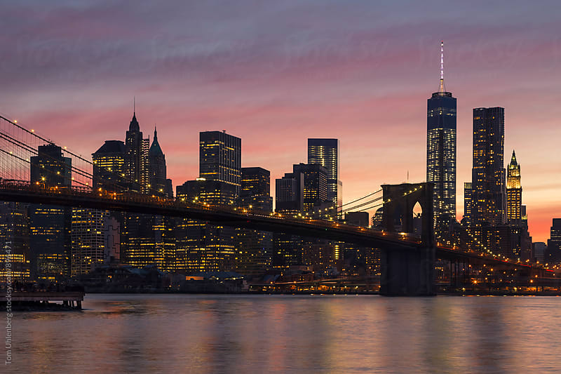 New York City - Lower Manhattan Skyline, Brooklyn Bridge and Afterglow Sky by Tom Uhlenberg for Stocksy United
