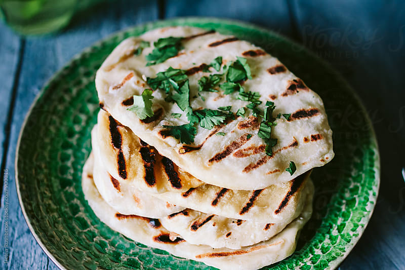 Flatbreads with coriander and mint tea by Helen Rushbrook for Stocksy United