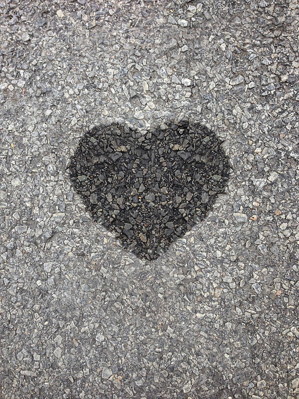A wet spot shaped like a heart  by Sandra Cunningham for Stocksy United