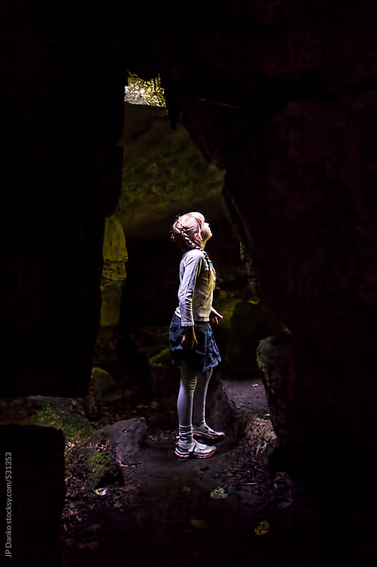 Little Girl Exploring A Dark Limestone Cave by JP Danko for Stocksy United
