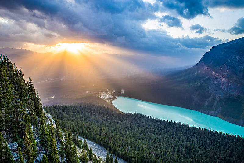 Lake Louise with sun rays by Song Heming for Stocksy United