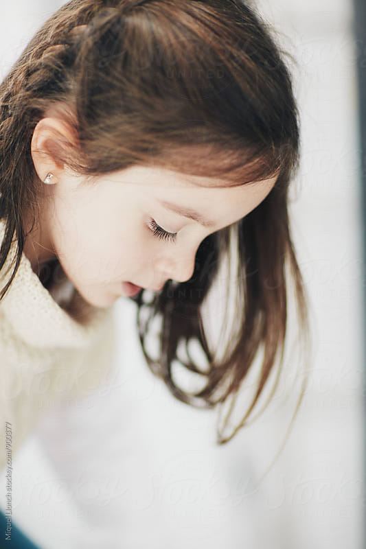 Close up of a little girl by Miquel Llonch for Stocksy United