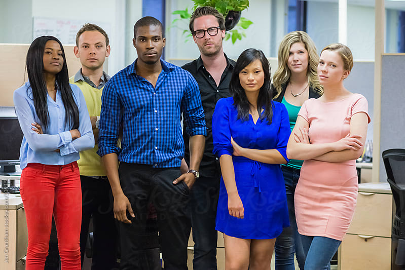 Diverse group of young office workers by Jen Grantham for Stocksy United