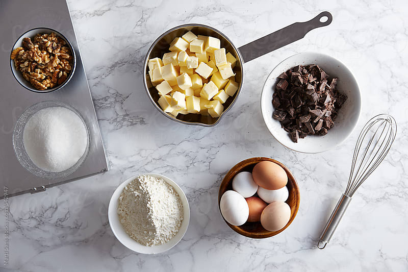 Ingredients for preparing a brownie by Martí Sans for Stocksy United