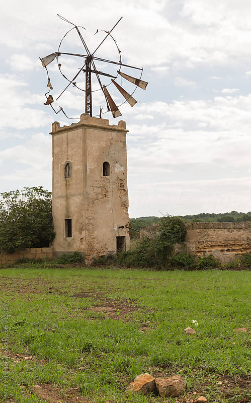 Old windmill abandoned in Mallorca by Marilar Irastorza for Stocksy United