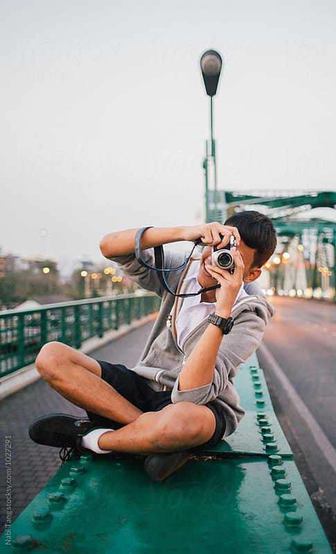 Teenage photographer taking a photo of me while I was shooting him by Nabi Tang for Stocksy United