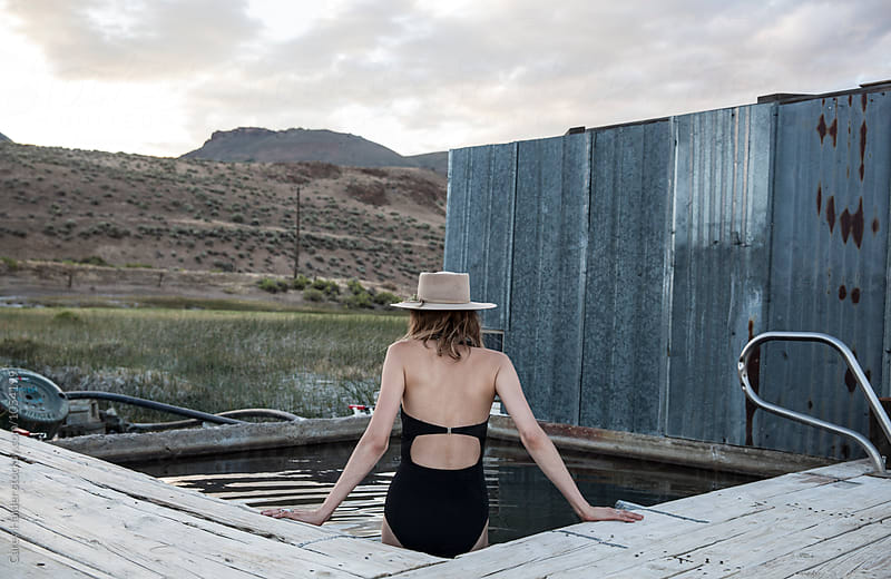 A Female Sitting At A Pool by Carey Haider for Stocksy United
