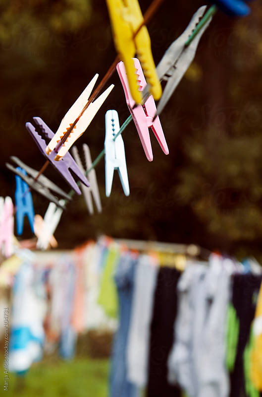 laundry with lot of colorful clips by Marija Anicic for Stocksy United