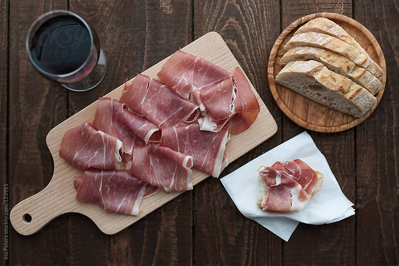 Food: Jamón Ibérico, sliced spanish ham by Ina Peters for Stocksy United