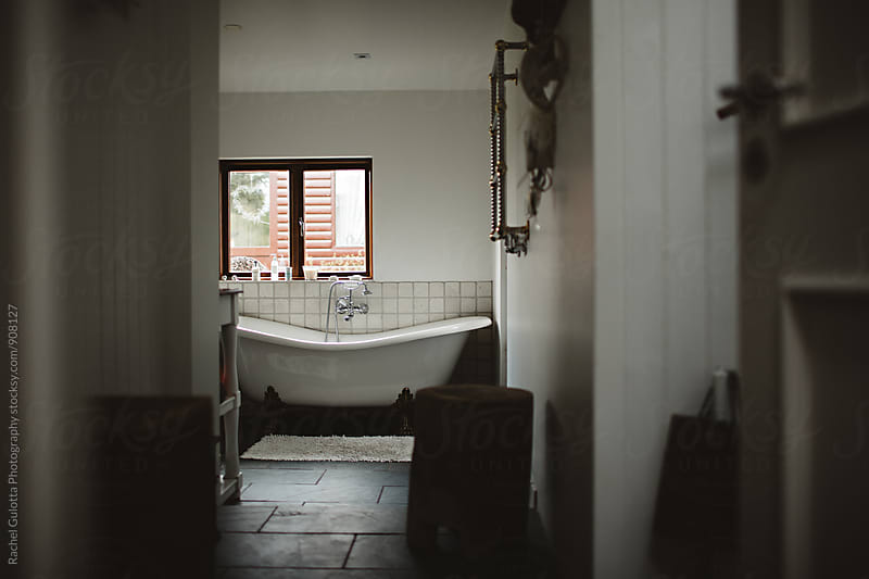 White Clawfoot Tub in Bathroom by Rachel Gulotta Photography for Stocksy United