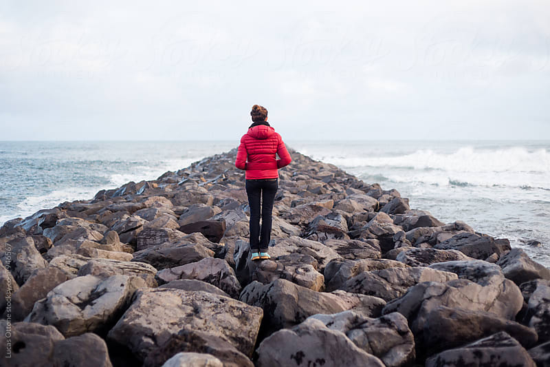 Lonely woman watching the sea by Lucas Ottone for Stocksy United