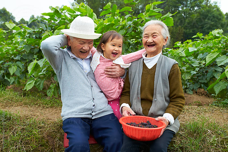little asian girl with her great grandparents outdoor by Bo Bo for Stocksy United