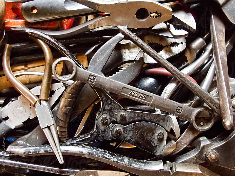 different types of pliers in a drawer, unsorted by Melanie Kintz for Stocksy United