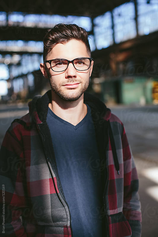 cool guy with glasses by Brian Powell for Stocksy United