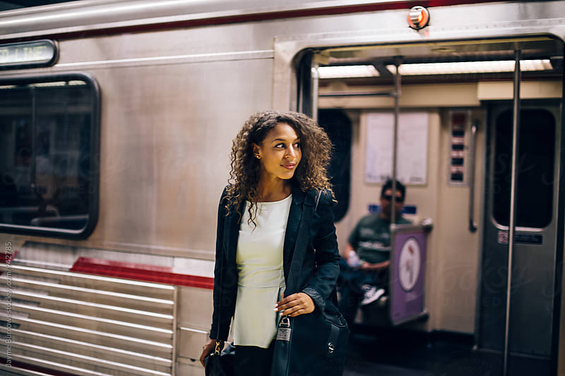 Young Professional Woman Leaves the Subway by Jayme Burrows for Stocksy United