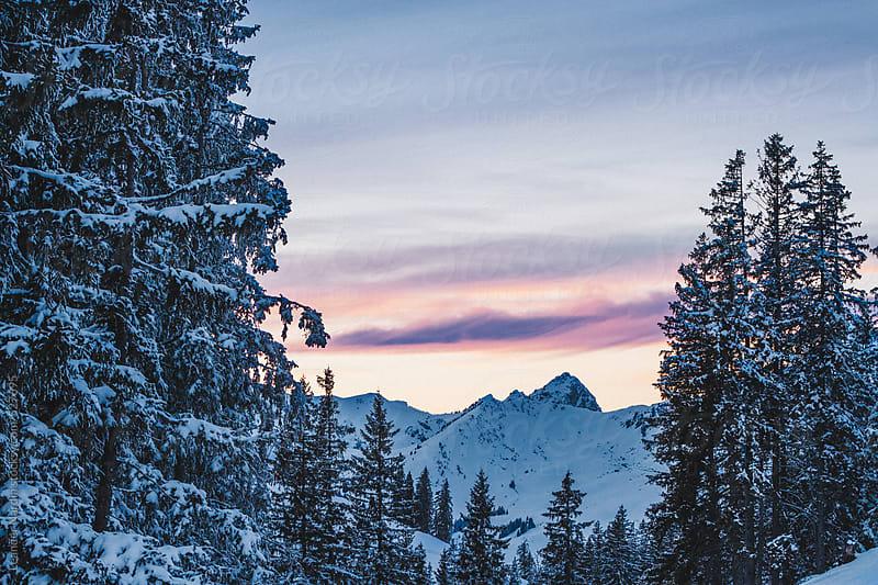 sunrise over snowcovered mountain scenery by Leander Nardin for Stocksy United