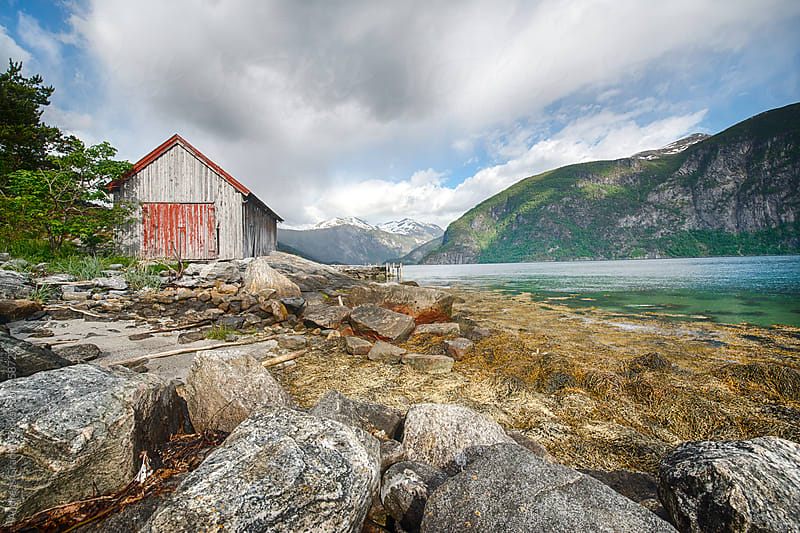 Fjord mountain landscape in Geiranger, Norway by Andreas Gradin for Stocksy United