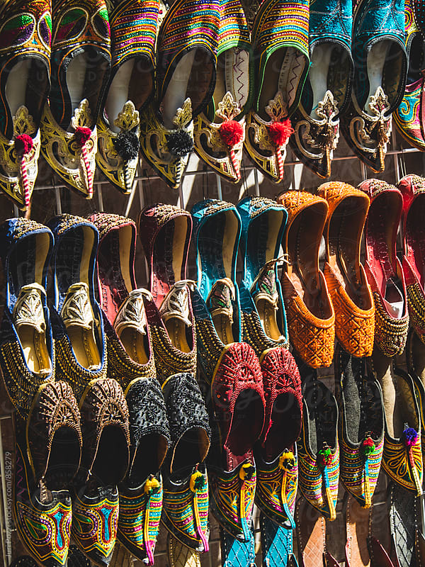 colorful shoes in souk Dubai by Juri Pozzi for Stocksy United