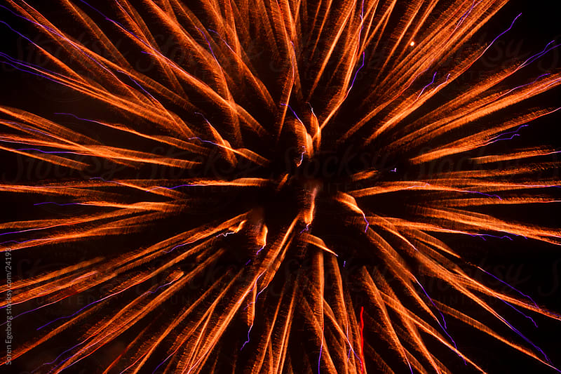 Red New Year Fireworks explosion in the night sky by Søren Egeberg Photography for Stocksy United