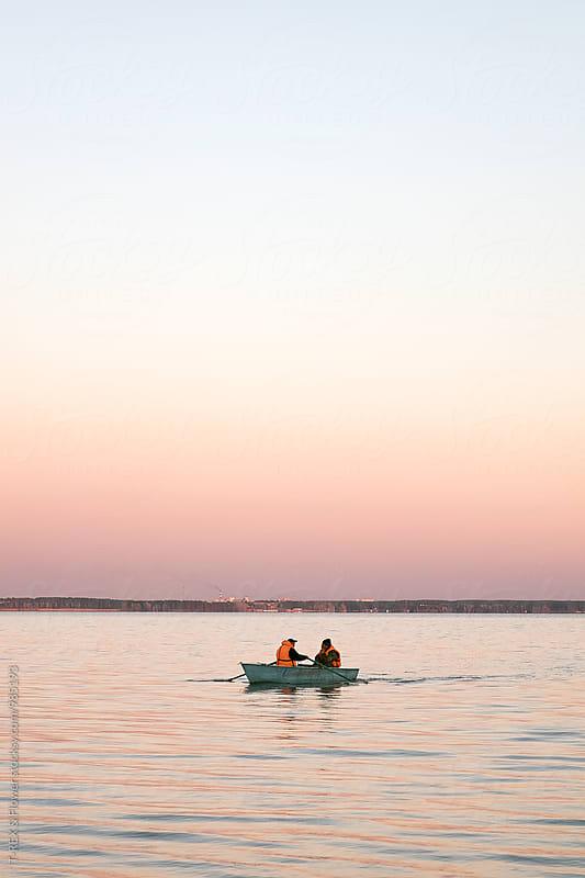 Two men sailing in boat by Danil Nevsky for Stocksy United