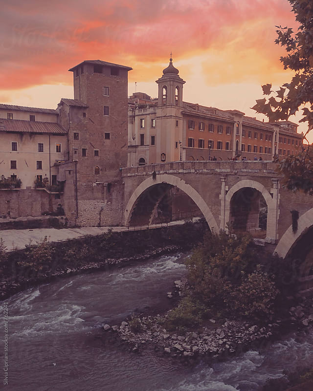 Tiber river at sunset in Rome by Silvia Cipriani for Stocksy United