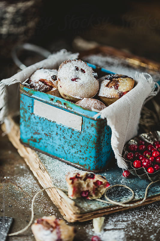 Homemade muffins with wild cranberries and white chocolate by Tatjana Ristanic for Stocksy United