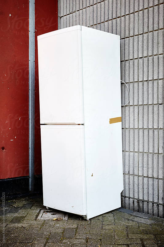An abandoned refrigerator by James Ross for Stocksy United