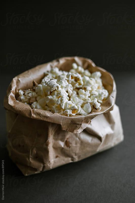 Full bag of popcorn. by Darren Muir for Stocksy United
