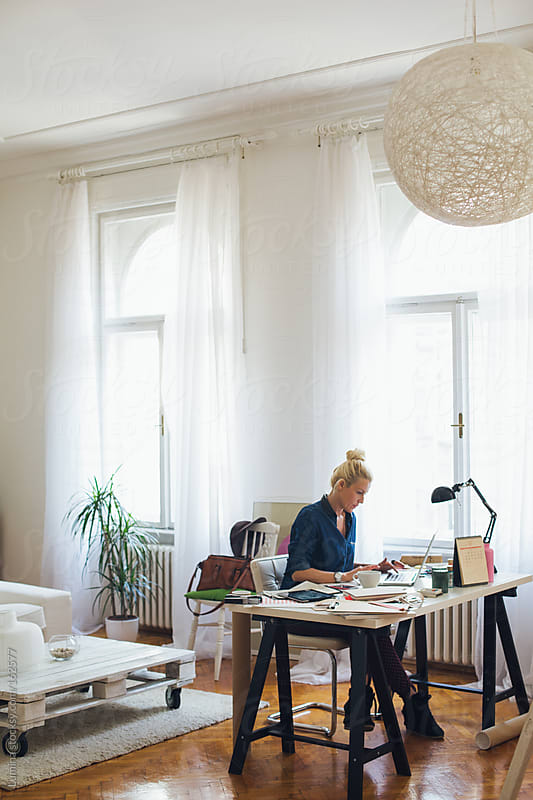 Businesswoman Working at Home by Lumina for Stocksy United
