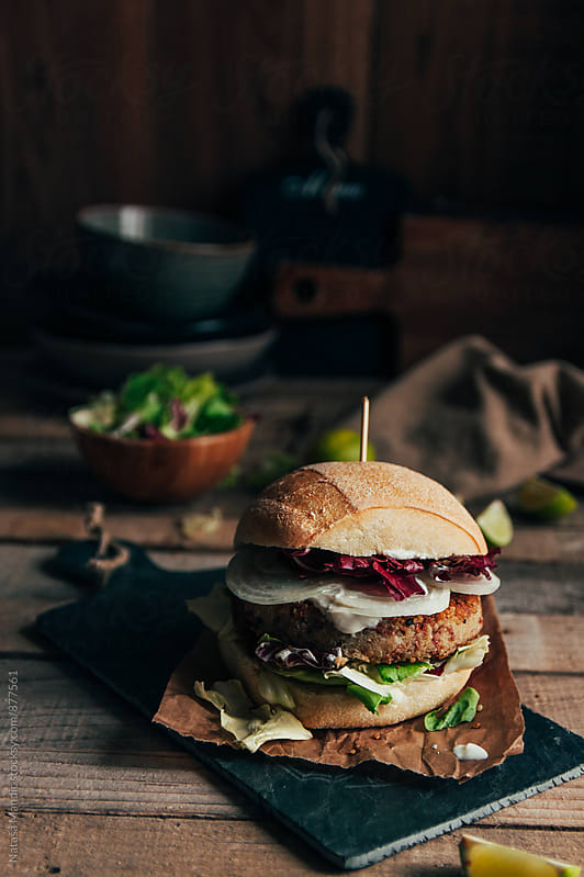 Quinoa burger with salad and onion by Nataša Mandić for Stocksy United