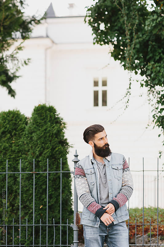 Stylish men walking down the street by Amir Kaljikovic for Stocksy United