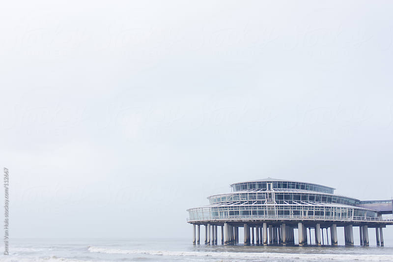 Pier sticking out in the ocean by Denni Van Huis for Stocksy United