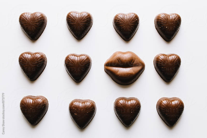 Grid of chocolate Valentine's Day hearts and lips candy by Carey Shaw for Stocksy United