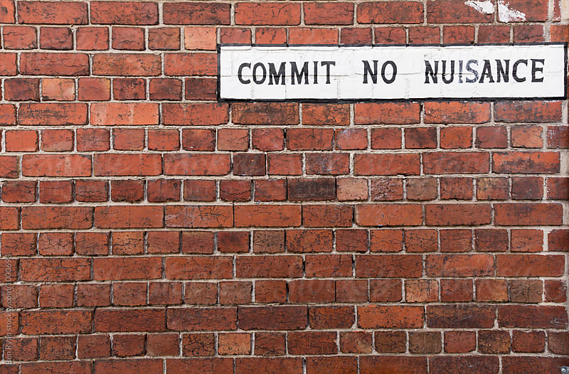 Vintage sign on red brick wall  - Commit No Nuisance by Ben Ryan for Stocksy United