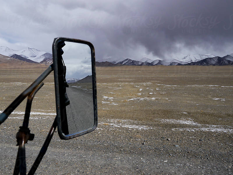 view from a truck as a rainstorm approaches by Amos Chapple for Stocksy United