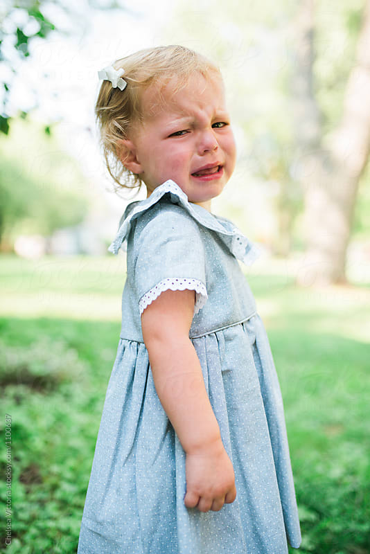 A little girl crying by Chelsea Victoria for Stocksy United