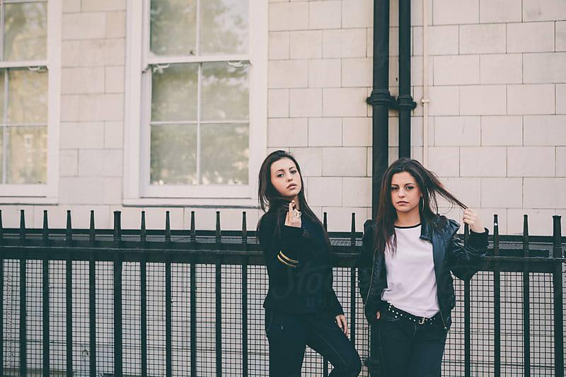 Twin teenage girls outdoors in London. by kkgas for Stocksy United