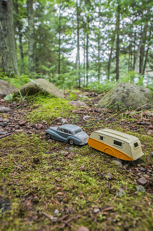 Antique Toy Car and Trailor Travel to their Vacation in the Wood by suzanne clements for Stocksy United